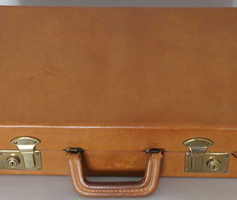 Suitcase in fawn leather